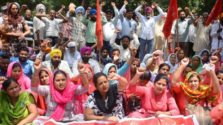 Activistas del Partido Comunista de la India en las celebraciones del Primero de Mayo